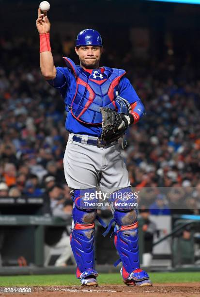 Willson Contreras of the Chicago Cubs looks to throw the ball out of the game against the San Francisco Giants in the bottom of the fourth inning at...