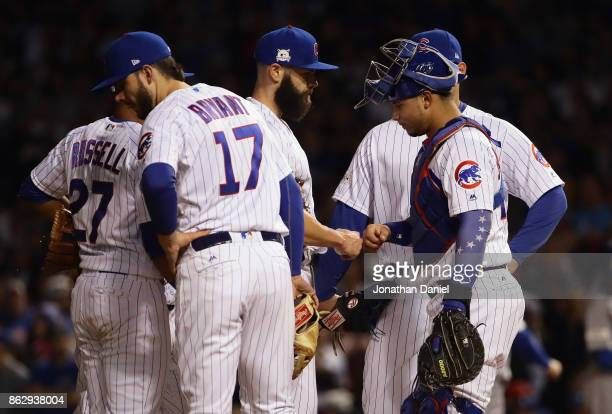 Willson Contreras of the Chicago Cubs meets with Jake Arrieta during a pitching change in the seventh inning against the Los Angeles Dodgers during...