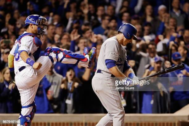 Willson Contreras of the Chicago Cubs reacts after Chase Utley of the Los Angeles Dodgers struck out in the eighth inning during game four of the...