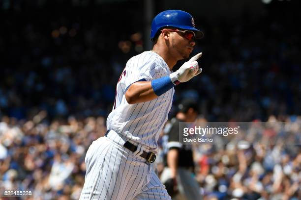 Willson Contreras of the Chicago Cubs reacts after hiting threerun homer against the Chicago White Sox during the first inning on July 25 2017 at...