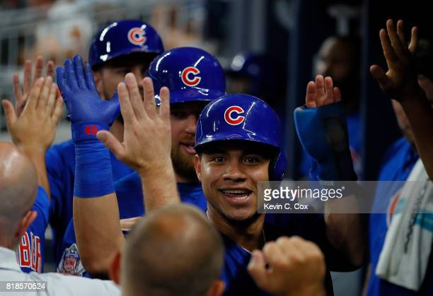 Willson Contreras of the Chicago Cubs reacts after hitting a threerun homer to score Ben Zobrist and Kris Bryant in the third inning against the...