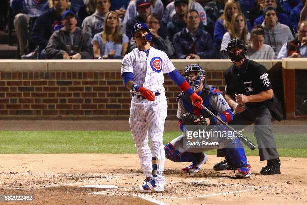 Willson Contreras of the Chicago Cubs reacts to hitting a home run in the second inning against the Los Angeles Dodgers during game four of the...