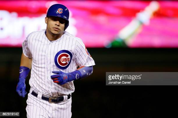 Willson Contreras of the Chicago Cubs rounds the bases after hitting a home run in the second inning against the Los Angeles Dodgers during game four...