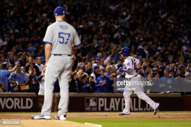 Willson Contreras of the Chicago Cubs rounds the bases after hitting a home run off Alex Wood of the Los Angeles Dodgers in the second inning during...