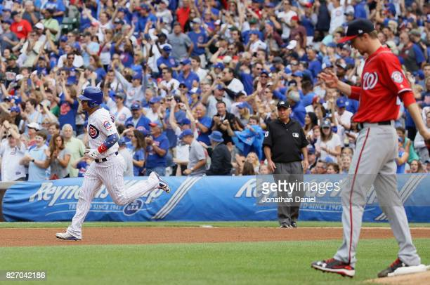 Willson Contreras of the Chicago Cubs runs the bases after hitting his second home run of the game a solol shot in the 6th inning off of Erick Fedde...