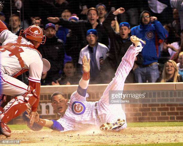 Willson Contreras of the Chicago Cubs scores as Andrew Knapp of the Philadelphia Phillies makes a late tag during the sixth inning on May 3 2017 at...