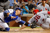 Willson Contreras of the Chicago Cubs tags out Aledmys Diaz of the St Louis Cardinals at home plate during the ninth inning at Wrigley Field on June...