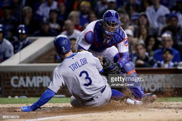 Willson Contreras of the Chicago Cubs tags out Chris Taylor of the Los Angeles Dodgers at home plate in the fourth inning during game five of the...