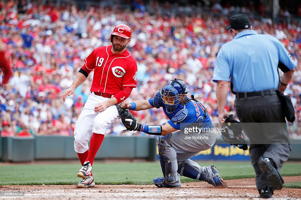 Willson Contreras #40 of the Chicago Cubs tags out Joey Votto #19 of the Cincinnati Reds as he tries to score in the third inning at Great American Ball Park on June 29, 2016 in Cincinnati, Ohio.