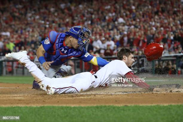 Willson Contreras of the Chicago Cubs tags out Trea Turner of the Washington Nationals at the plate during the first inning in game five of the...