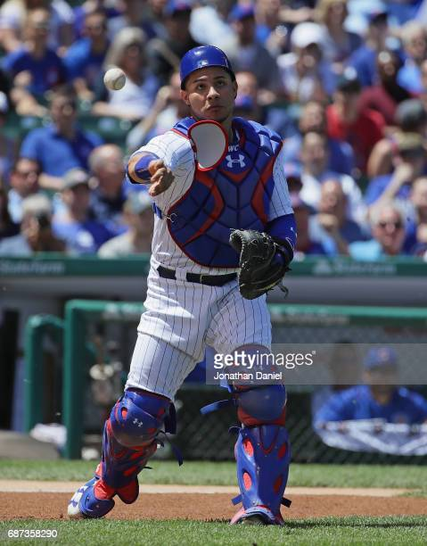 Willson Contreras of the Chicago Cubs throws out a Cincinnati Reds runner at Wrigley Field on May 18 2017 in Chicago Illinois The Cubs defeated the...