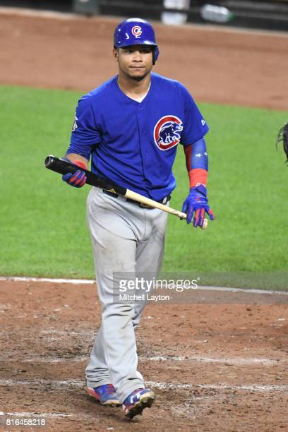 Willson Contreras of the Chicago Cubs walks back to the dug out during a baseball game against the Baltimore Orioles at Oriole Park at Camdens Yards...