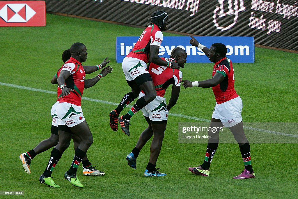Willy Ambaka (R) of Kenya is congratulated on his winning try by teammates after winning the semifinal cup match between New Zealand and Kenya during the 2013 Wellington Sevens at Westpac Stadium on February 2, 2013 in Wellington, New Zealand.