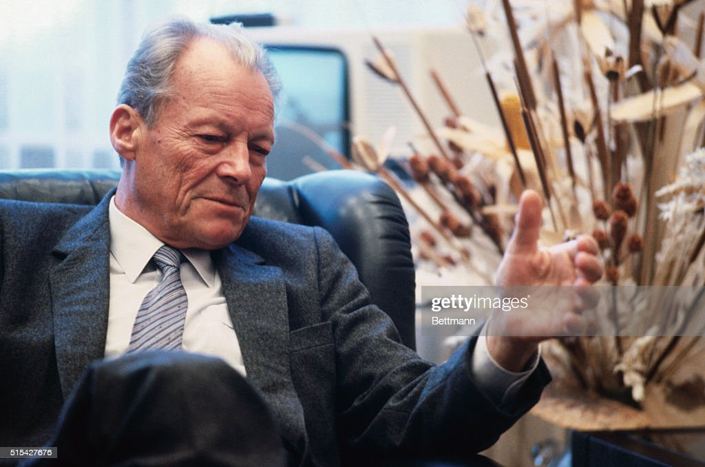 Willy Brandt, former West German Chancellor, seated in his office at the Bundestag during an interview with James Barry.