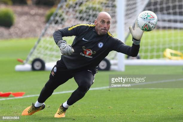 Willy Caballero of Chelsea makes a serve during a training session at Chelsea Training Ground on September 19 2017 in Cobham England