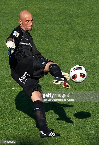 Willy Caballero of Malaga in action during the La Liga match between Malaga and Barcelona at La Rosaleda Stadium on May 21 2011 in Malaga Spain...