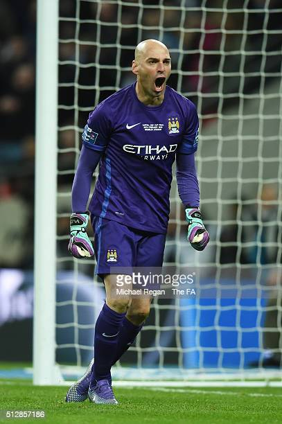 Willy Caballero of Manchester City celebrates after saving a penalty in the shoot out during the Capital One Cup Final between Liverpool and...