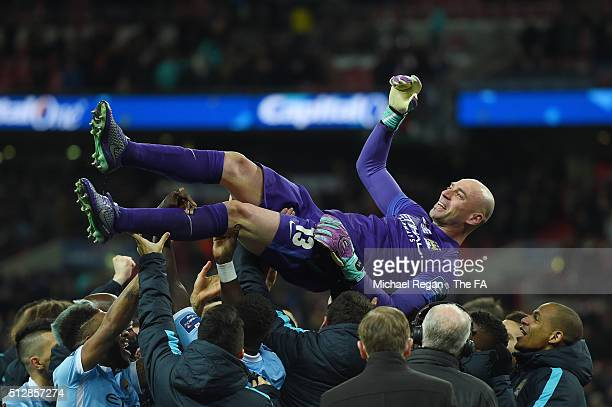 Willy Caballero of Manchester City celebrates victory with his team mates after the penalty shoot out during the Capital One Cup Final between...
