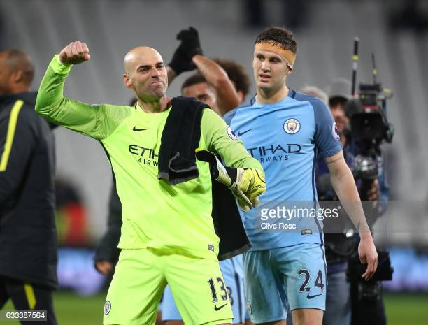 Willy Caballero of Manchester City celebrates with John Stones after the Premier League match between West Ham United and Manchester City at London...