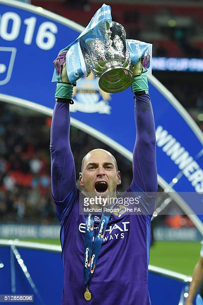 Willy Caballero of Manchester City celebrates with the trophy after the Capital One Cup Final between Liverpool and Manchester City at Wembley...