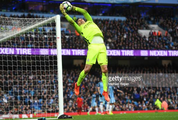 Willy Caballero of Manchester City makes a save during the Premier League match between Manchester City and Liverpool at Etihad Stadium on March 19...