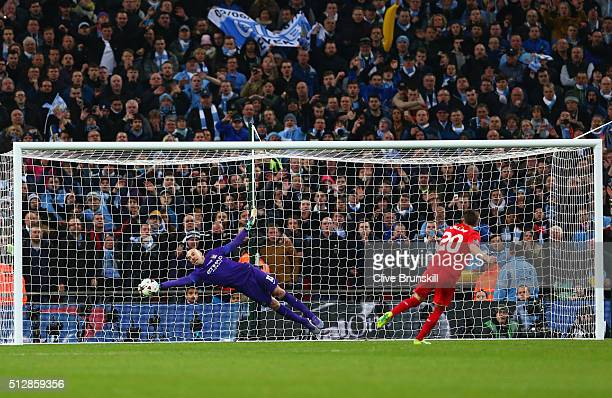 Willy Caballero of Manchester City saves a penalty from Adam Lallana of Liverpool in the shoot out during the Capital One Cup Final match between...