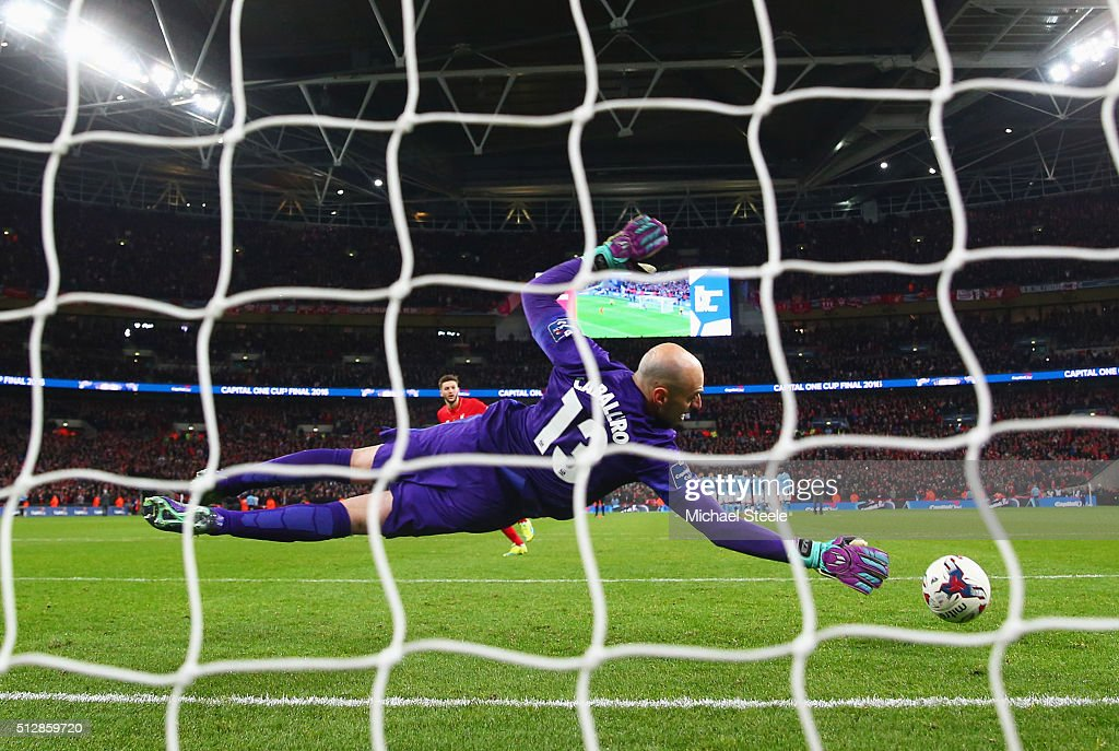 Willy Caballero of Manchester City saves a penalty from Adam Lallana of Liverpool in the shoot out during the Capital One Cup Final match between Liverpool and Manchester City at Wembley Stadium on February 28, 2016 in London, England.