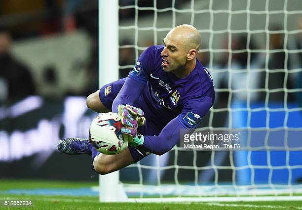 Willy Caballero of Manchester City saves a penalty from Philippe Coutinho of Liverpool in the shoot out during the Capital One Cup Final between...