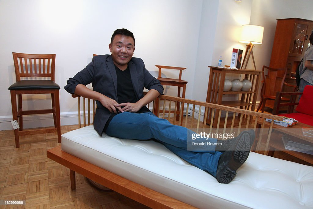 Willy Chan sits on the chair he designed during The CITY MODERN Presented By New York And Dwell Magazines Host The Apprentice: Furniture Making With Thos. Moser at Thos. Moser on October 2, 2013 in New York City.