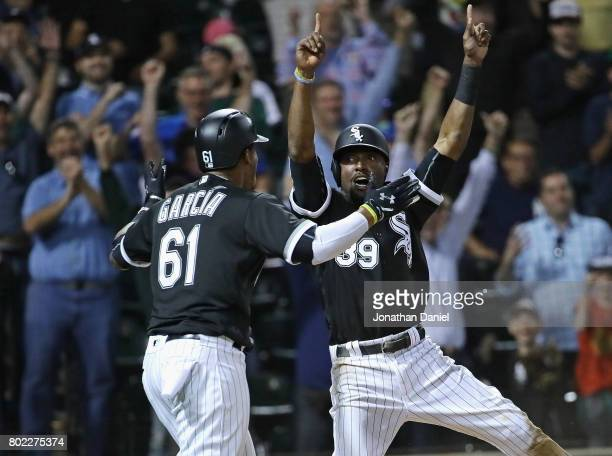 Willy Garcia and Alen Hanson of the Chicago White Sox celebrate after scoring the tying and winning runs in the 9th inning against the New York...