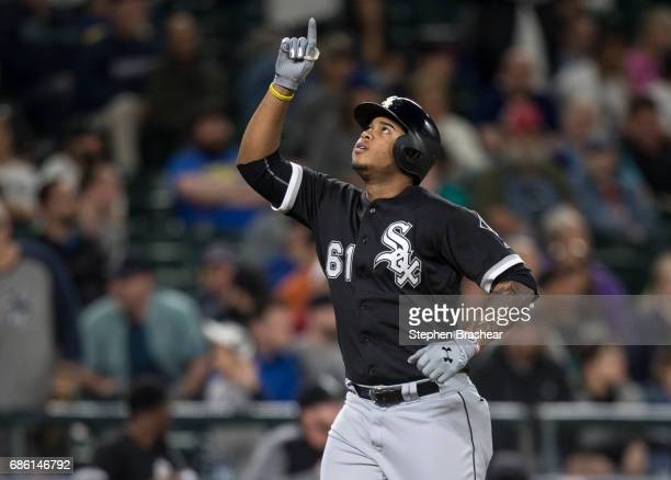 Willy Garcia of the Chicago White Sox celebrates hitting a solo home run off of relief pitcher Dillon Overton of the Seattle Mariners during the...