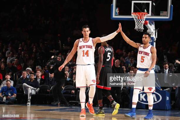 Willy Hernangomez and Courtney Lee New York Knicks high five against the Toronto Raptors on February 27 2017 at Madison Square Garden in New York...