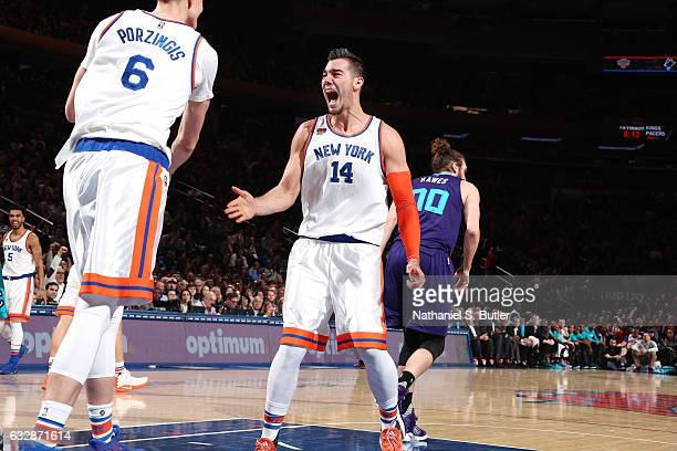 Willy Hernangomez and Kristaps Porzingis of the New York Knicks high five each other during the game against the Charlotte Hornets on January 27 2017...