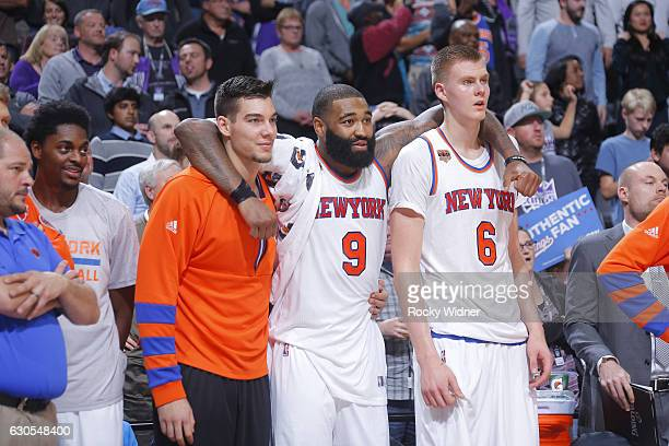 Willy Hernangomez Kyle O'Quinn and Kristaps Porzingis of the New York Knicks cheer on their teammates against the Sacramento Kings on December 9 2016...