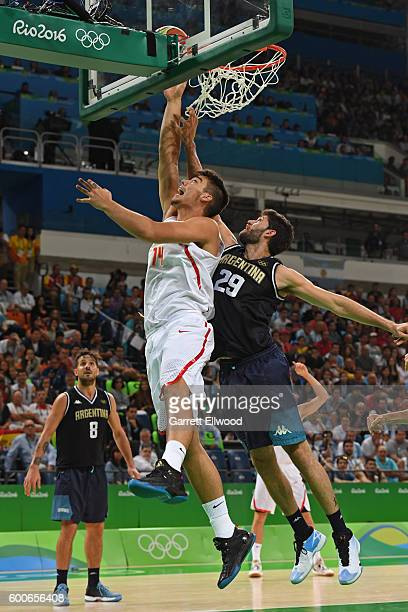 Willy Hernangomez of Spain shoots the ball against Patricio Garino of Argentina on Day 10 of the Rio 2016 Olympic Games at Carioca Arena 1 on August...