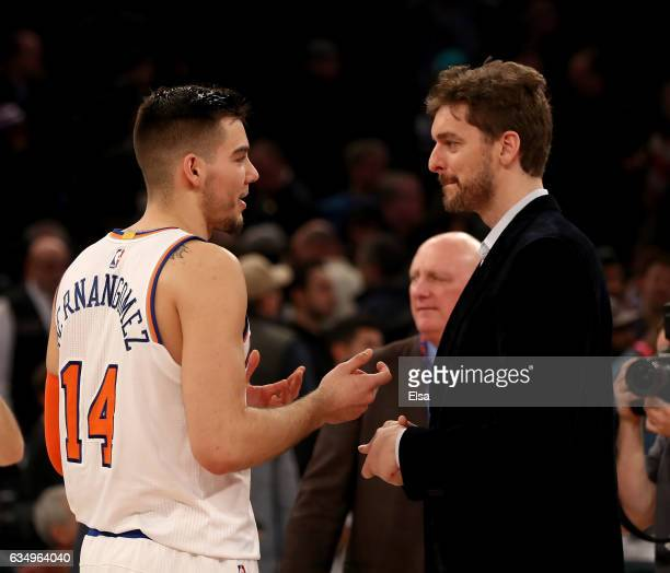 Willy Hernangomez of the New York Knicks and Pau Gasol of the San Antonio Spurs talk after the game at Madison Square Garden on February 12 2017 in...