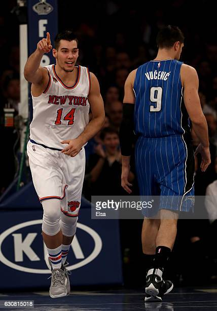 Willy Hernangomez of the New York Knicks celebrates his dunk as Nikola Vucevic of the Orlando Magic looks on in the first hat at Madison Square...
