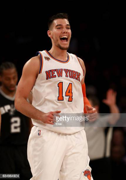 Willy Hernangomez of the New York Knicks celebrates his dunk in the second half against the San Antonio Spurs at Madison Square Garden on February 12...