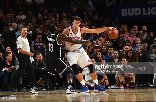 Willy Hernangomez of the New York Knicks controls the ball against the Brooklyn Nets in a preseason game at Madison Square Garden on October 8 2016...