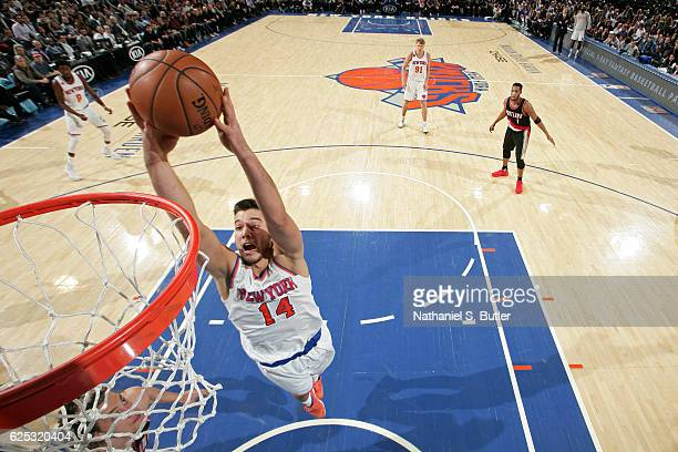 Willy Hernangomez of the New York Knicks drives to the basket against the Portland Trail Blazers on November 22 2016 at Madison Square Garden in New...