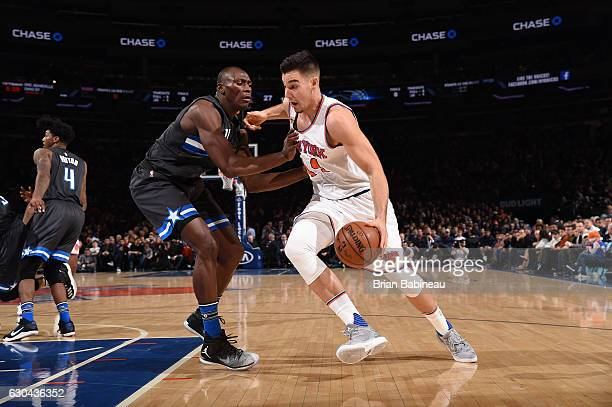 Willy Hernangomez of the New York Knicks drives to the basket against Bismack Biyombo of the Orlando Magic during a game on December 22 2016 at...