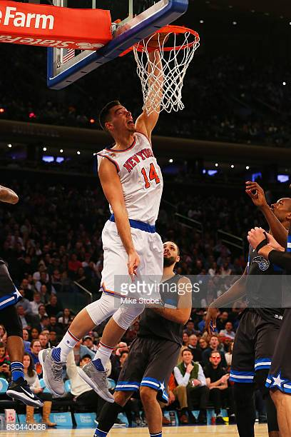 Willy Hernangomez of the New York Knicks dunk the ball against the Orlando Magic at Madison Square Garden on December 22 2016 in New York City