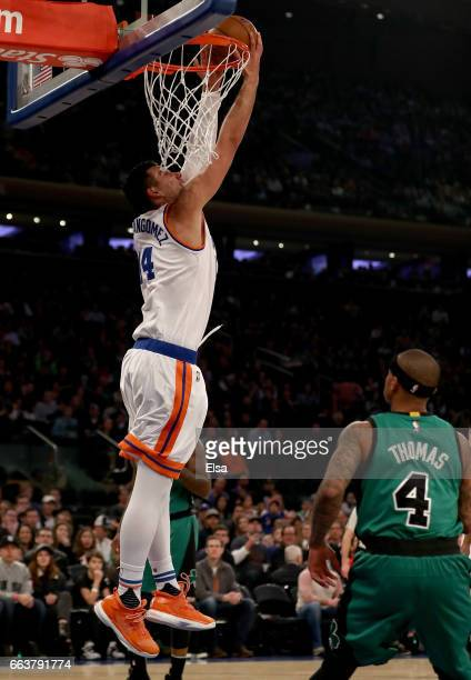 Willy Hernangomez of the New York Knicks dunks as Isaiah Thomas of the Boston Celtics looks on in the first quarter at Madison Square Garden on April...