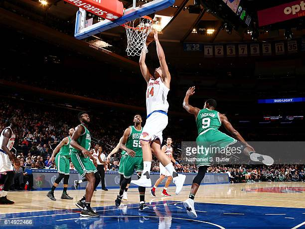Willy Hernangomez of the New York Knicks goes for a dunk against the Boston Celtics on October 15 2016 at Madison Square Garden in New York City New...