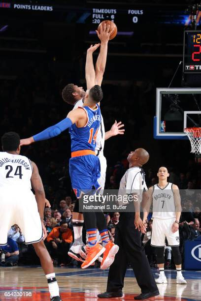 Willy Hernangomez of the New York Knicks goes for the tip off against Brook Lopez of the Brooklyn Nets on March 16 2017 at Madison Square Garden in...