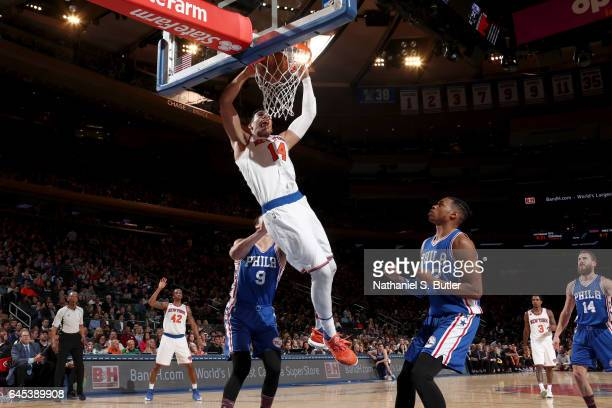 Willy Hernangomez of the New York Knicks goes to the basket against the Philadelphia 76ers on February 25 2017 at Madison Square Garden in New York...