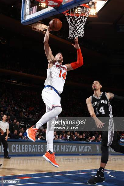 Willy Hernangomez of the New York Knicks goes up for a dunk against the San Antonio Spurs on February 12 2017 at Madison Square Garden in New York...