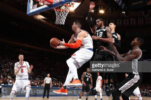 Willy Hernangomez of the New York Knicks goes up for a lay up against the San Antonio Spurs on February 12 2017 at Madison Square Garden in New York...