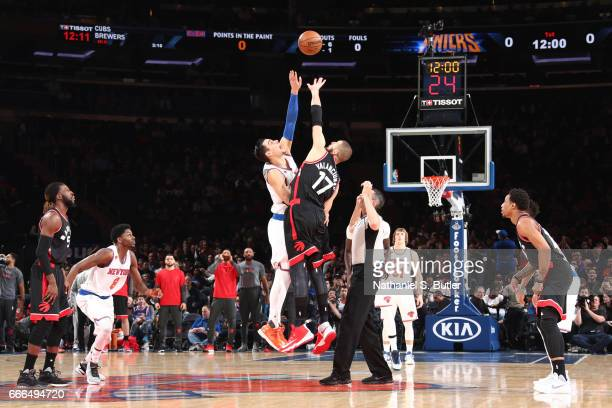 Willy Hernangomez of the New York Knicks goes up for the opening tip off against Jonas Valanciunas of the Toronto Raptors on April 9 2017 at Madison...