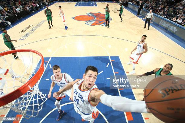 Willy Hernangomez of the New York Knicks grabs the rebound during a game against the Boston Celtics on April 2 2017 at Madison Square Garden in New...